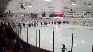 The Oil Barons and Wolverines stand across their respective bluneline during the national anthem. April 9, 2017/Taylor Pope/Rogers Media.